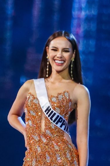 Miss Universe 2018 Miss Philippines Catriona Gray with long straight black hair wearing an evening gown on stage