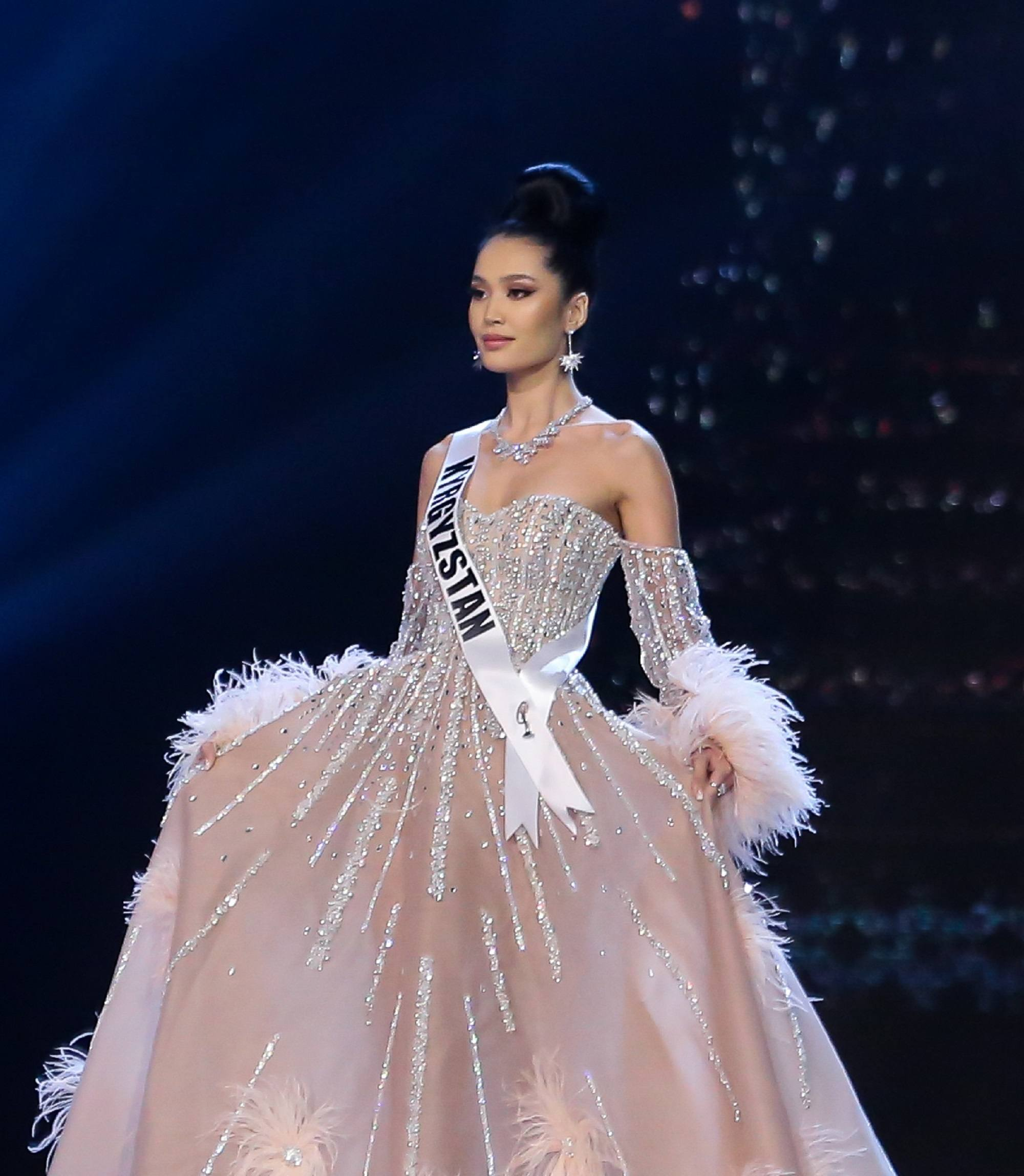 Miss Universe 2018 hairstyles : Ms. Kyrgyzstan Begimay Karybekova with black hair in a bun and light pink ball gown on stage