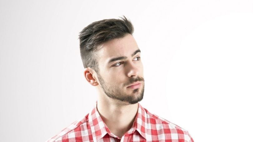 Dandruff solutions: Caucasian man with short dark hair and mustache wearing a red and white checkered top