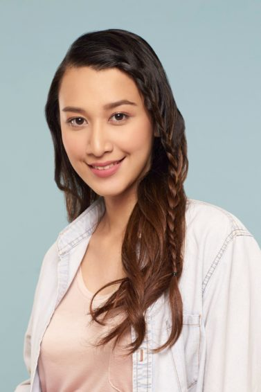 Simple braids: Asian woman wearing a white polo with long dark hair in face framing lace braid