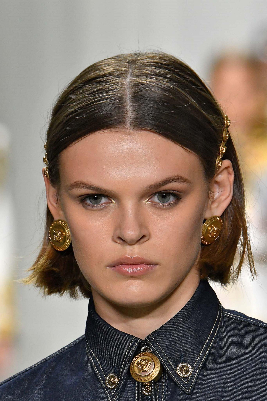 Hair clip hairstyles: Closeup shot of a woman with dark hair in a bob wearing hair clips