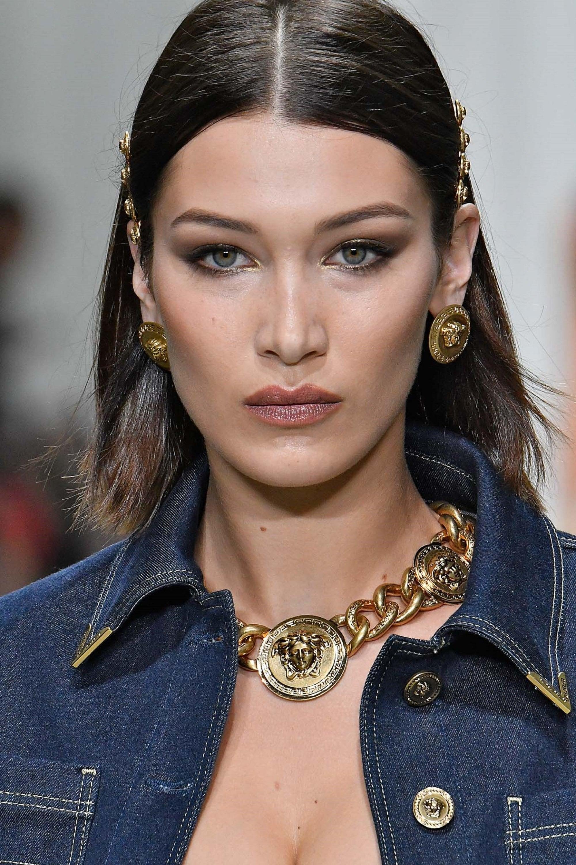 Hair clip hairstyles: Closeup shot of a woman with medium-length black hair wearing hair clips