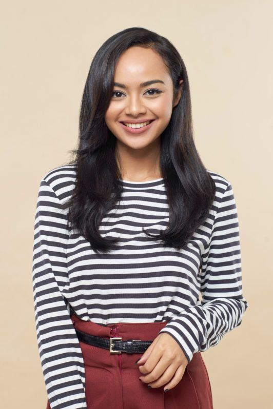 Pin up hair: Asian woman with long black hair wearing a long sleeved striped top