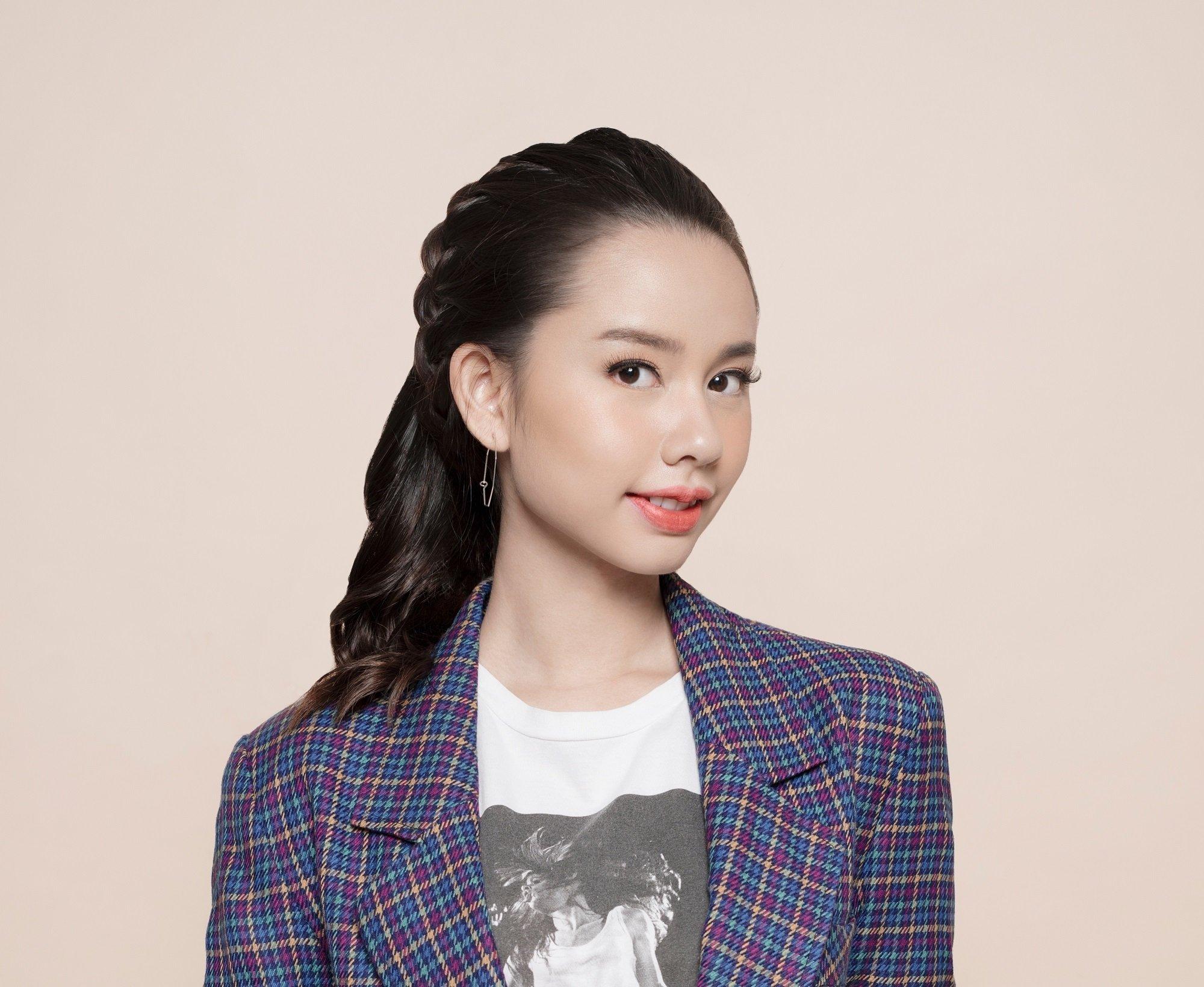 Pretty braids: Closeup shot of an Asian woman with long black hair in a headband braid hairstyle