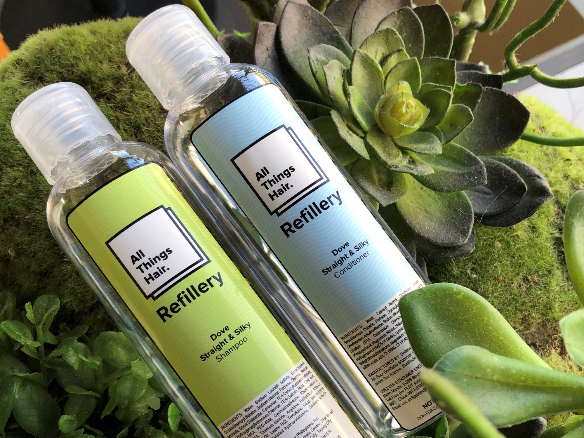 All Things Hair Refillery: ATH Refillery bottles with leaves at the background