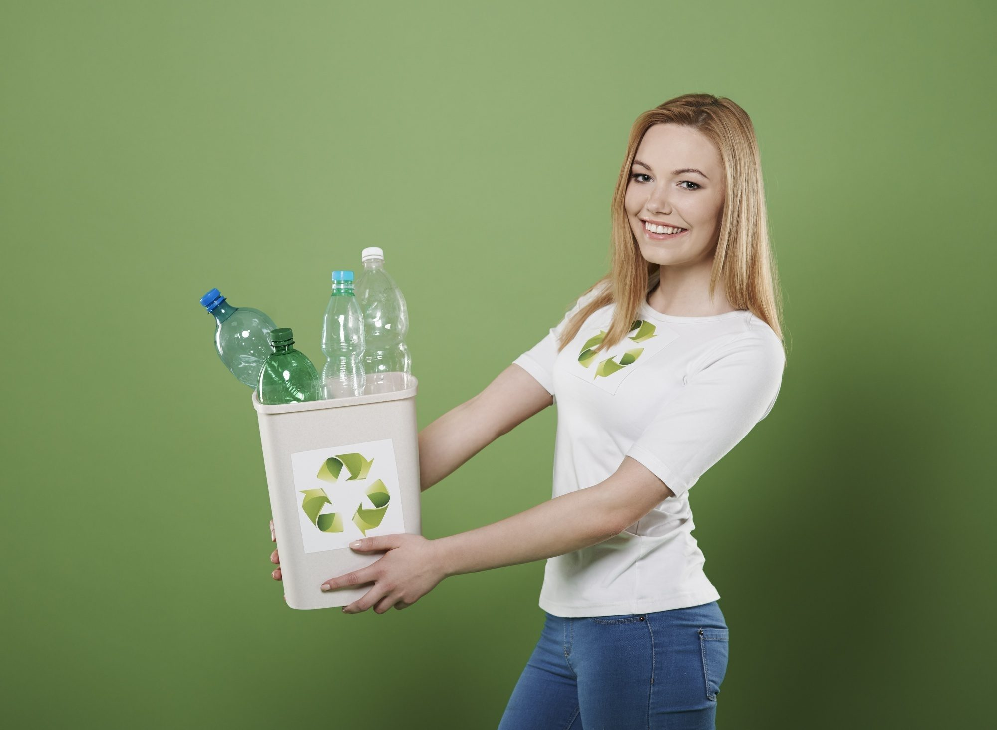 All Things Hair Refillery: Blonde woman holding a container with plastic recyclable bottles