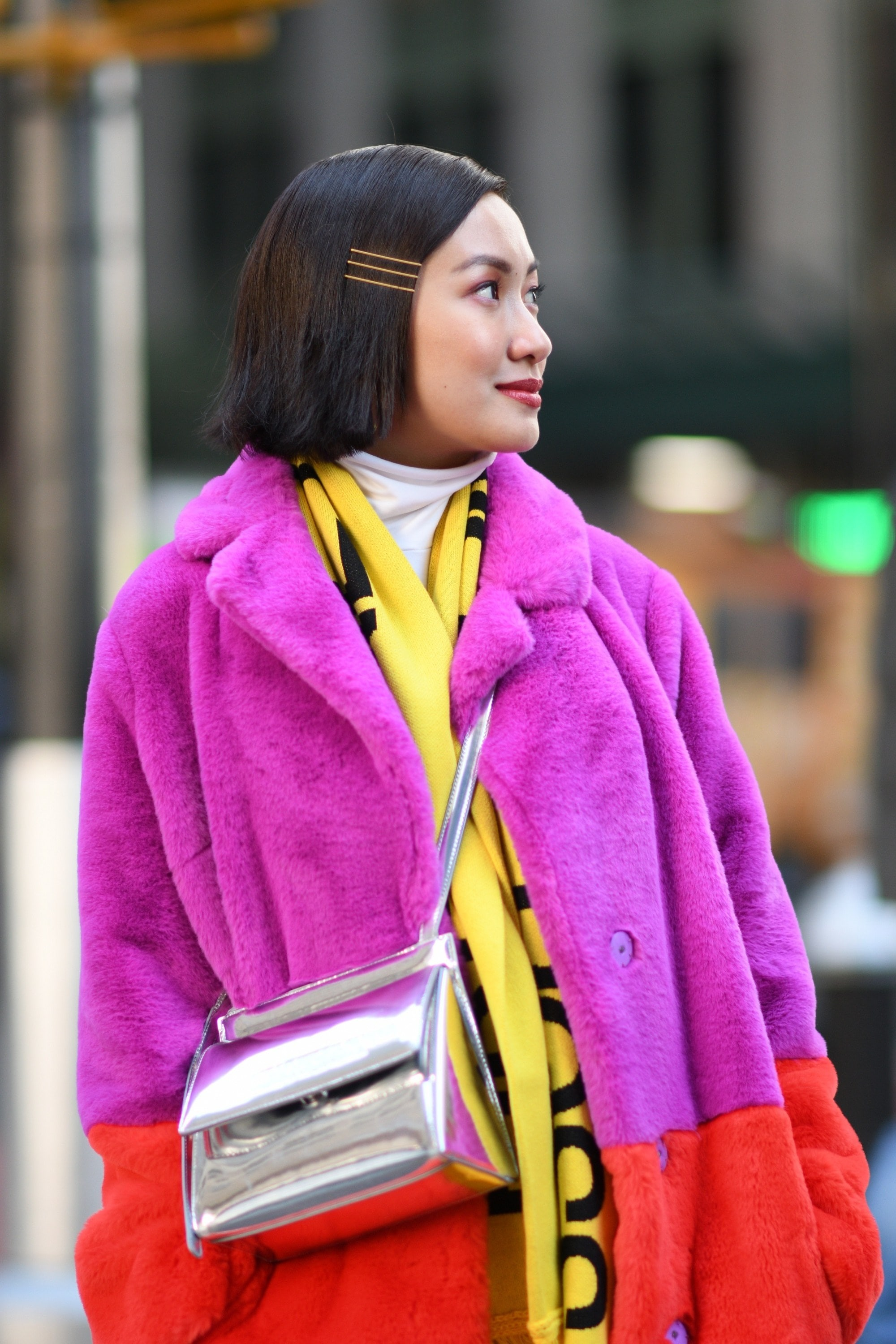 International Women's Day: Filipina woman with short black hair wearing a pink coat for NYFW