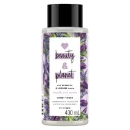 Bottle of Love Beauty and Planet purple conditioner