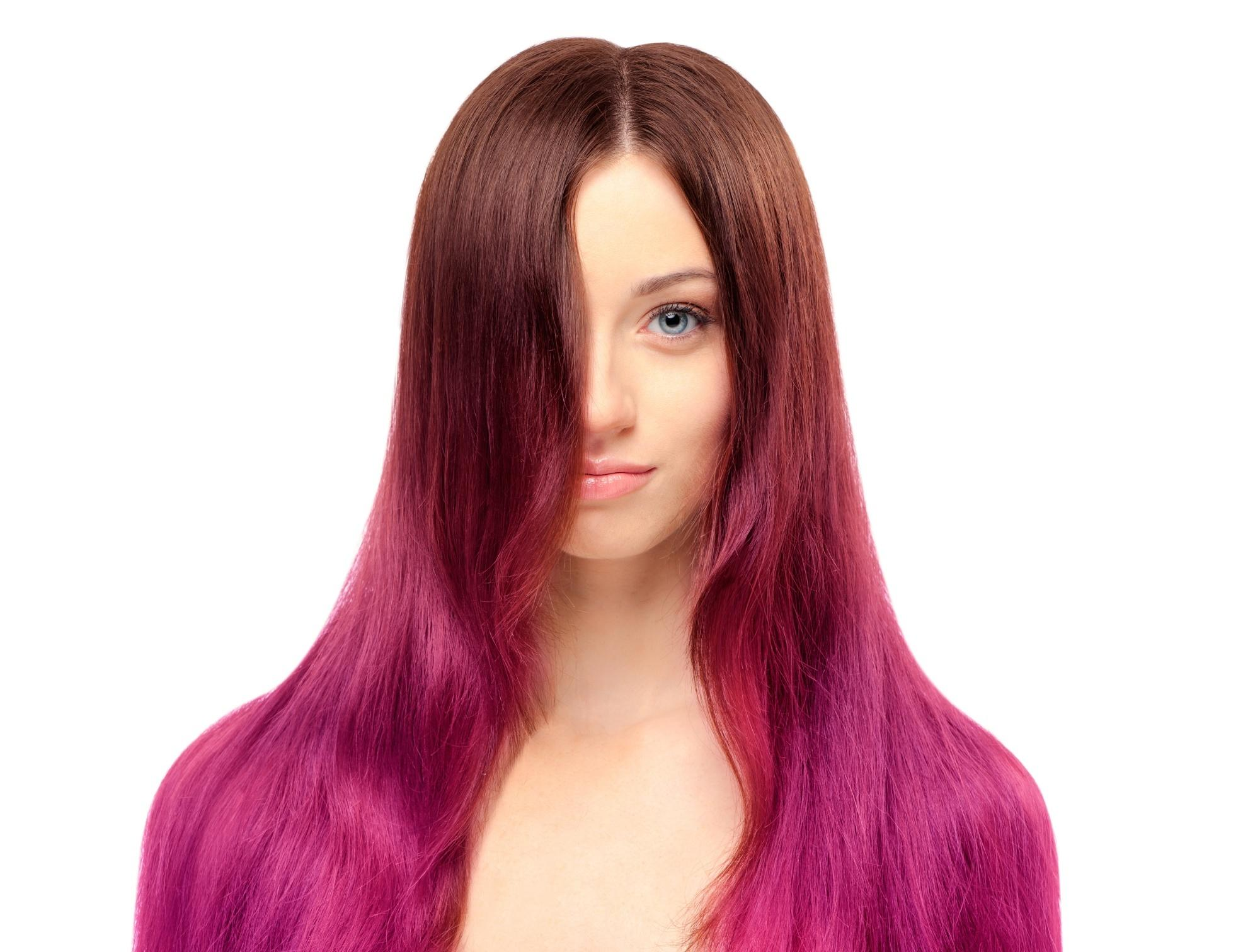 Pink ombre hair: Woman with long brown and pink ombre hair
