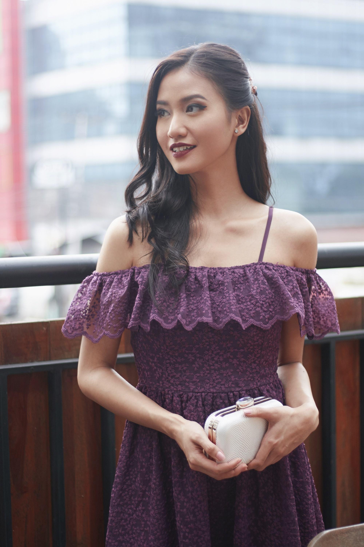 Summer-ready hair: Asian woman with long dark wavy hair wearing a plum dress outdoors