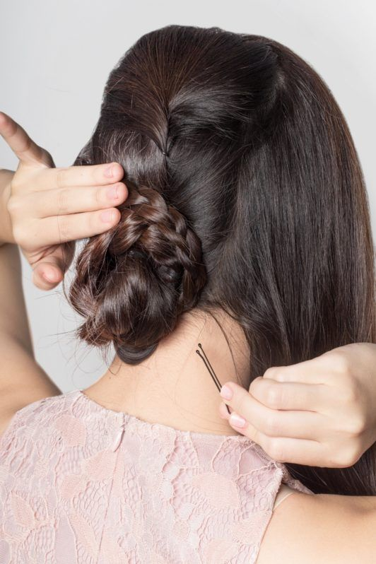 Lace braid updo: Back shot of an Asian woman styling her dark hair